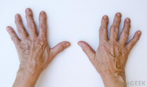 close-view-of-two-hands-against-white-background